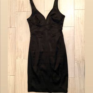 Fitted black plunging neck line dress.